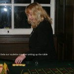 Dina setting up the casino roulette table