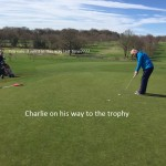 Golf match - Chrlie on his way to winning the trophy